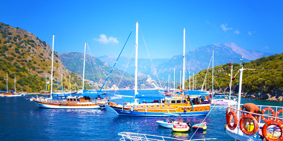 Excursion ships and islands in azure waters of the Mediterranean sea, Oludeniz, Turkey