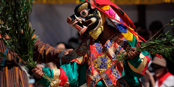 Costumed and masked dancers, Bumthang, Bhutan