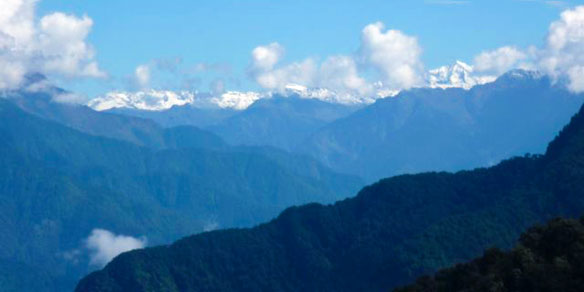 Snow capped peaks as seen from Mayudhia Pass, India