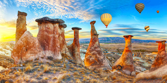 Rocks looking like mushrooms dramatically lit by a sunset, Goreme Valley, Cappadocia, Turkey